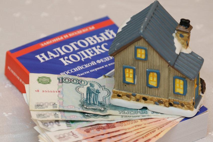 кто платит налог на недвижимость